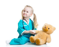 Kid girl playing doctor Stock Photography
