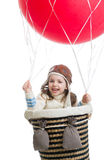 Kid girl playing on hot air balloon Stock Photos