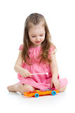Kid girl playing musical toy Royalty Free Stock Images