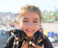 Kid girl playing with puppy dogs smiling Royalty Free Stock Photography