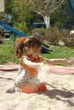 Kid girl playing in a sandpit Royalty Free Stock Photography