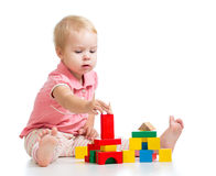 Kid girl playing toy blocks and building tower Royalty Free Stock Images