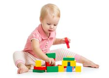 Kid girl playing toy blocks isolated on white Stock Photos