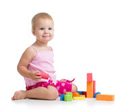 Kid girl playing toy blocks on white Royalty Free Stock Photo