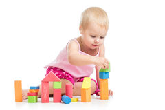 Kid girl playing toy blocks on white background royalty free stock photography