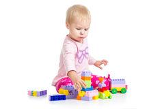 Kid girl playing toy blocks on white background Royalty Free Stock Images