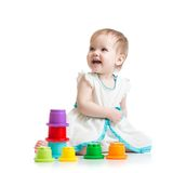 Kid girl playing with toys Royalty Free Stock Photography
