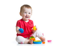 Kid girl playing with toys Royalty Free Stock Photos