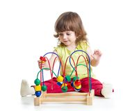 Kid girl plays with educational toy isolated. On white stock photography