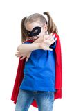 Kid girl plays superhero Royalty Free Stock Images