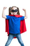 Kid girl plays superhero. Isolated on white royalty free stock photo