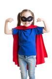 Kid girl plays superhero royalty free stock image