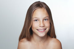 Kid girl. Portrait of 7 years old smiling kid girl royalty free stock image