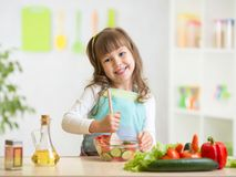 Kid girl preparing healthy food Royalty Free Stock Photo