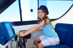 Kid girl pretending be a captain sailor cap in boat Royalty Free Stock Photography