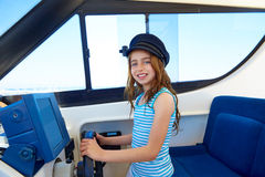 Kid girl pretending be a captain sailor cap in boat Stock Photography