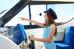 Kid girl pretending be a captain sailor cap in boat Stock Images