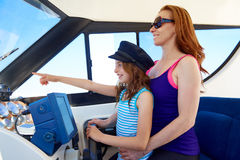 Kid girl pretending be a sailor with her mother Stock Photo