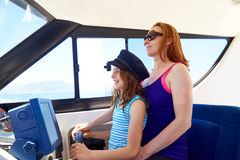 Kid girl pretending be a sailor with her mother Royalty Free Stock Images