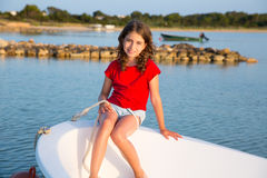Kid girl pretending to be sailor in boat bow at Formentera Royalty Free Stock Images