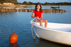 Kid girl pretending to be sailor in boat bow at Formentera Stock Image