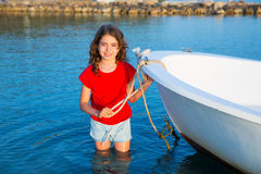 Kid girl pretending to be sailor in boat bow at Formentera Stock Images