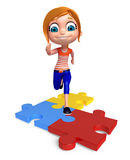 Kid girl with Puzzel Stock Photo
