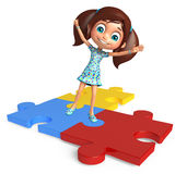 Kid girl with Puzzel Stock Images