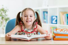 Kid girl reading a book Stock Image