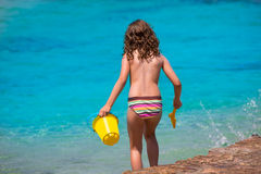 Kid girl rear view in beach tropical turquoise water Royalty Free Stock Image