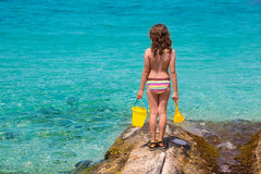 Kid girl rear view in beach tropical turquoise water Stock Images