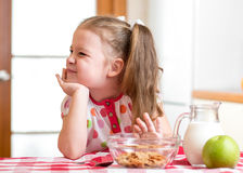 Kid girl refuses to eat healthy food stock photography