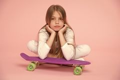 Kid girl relax lean penny board. Modern youth hobby. Active leisure concept. Girl lean on penny board pink background. Originally designed girls skateboard stock images
