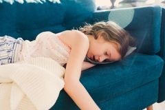 Kid girl relaxing at home in weekend morning and sleeping stock photography