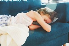 Happy child girl sleeping at home in cozy weekend morning Royalty Free Stock Images