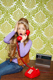 Kid girl retro talking busybody in red telephone Royalty Free Stock Image