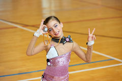 Kid girl rhythmic gymnastics on wooden deck Royalty Free Stock Photo