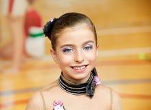 Kid girl rhythmic gymnastics on wooden deck Stock Image