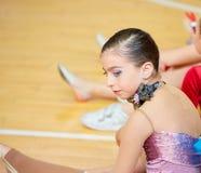Kid girl rhythmic gymnastics on wooden deck Stock Images