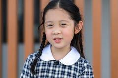 Kid, Girl, in School Uniform. Smiling kid, girl, in school uniform portrait royalty free stock photo
