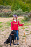 Kid girl shepherdess happy with dog and flock of sheep Royalty Free Stock Photography