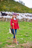 Kid girl shepherdess happy with flock of sheep and stick Royalty Free Stock Photos