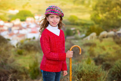 Kid girl shepherdess with wooden baston in Spain village Royalty Free Stock Photos