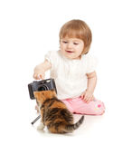 Kid girl shooting small cat Stock Image