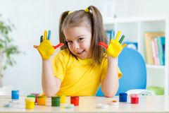 Kid girl showing painted hands Royalty Free Stock Images