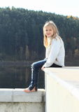 Kid - girl sitting on roof Royalty Free Stock Photography