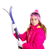 Kid girl ski with snow equipment goggles and winter hat Royalty Free Stock Photography
