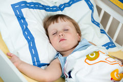 Kid girl sleeping. In the bed stock photography