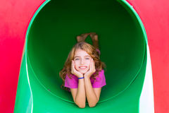 Kid girl smiling in the park playground relaxed. With hands in face royalty free stock photography