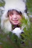 Kid girl with snow portrait closeup Stock Image